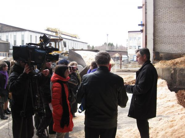 Viktor Gonchar talk to media on wood waste boiler in his enterprise